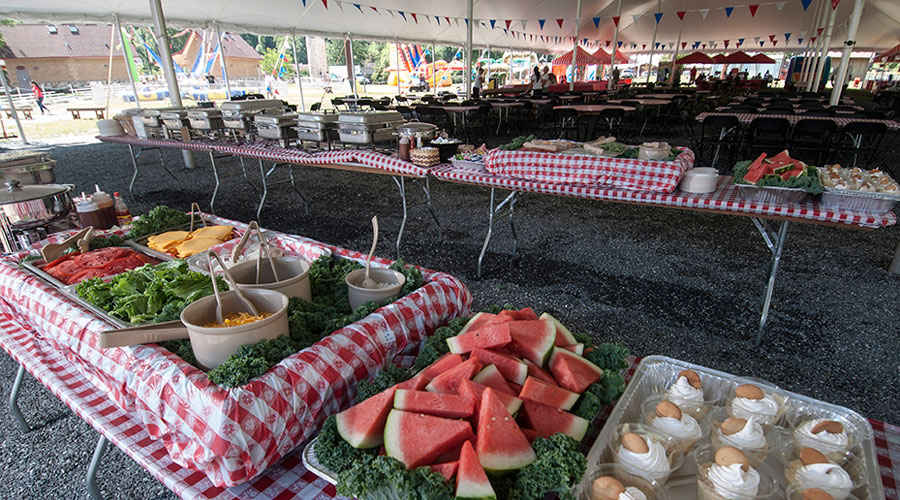 full catering setup under a big tent at event