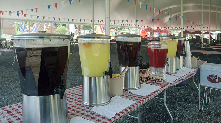 drink dispensers at outdoor catered event
